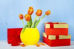 Bouquet of tulips and boxes Royalty Free Stock Photo