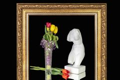 Bouquet of tulips and a bust of Venus in a frame for paintings royalty free stock photos