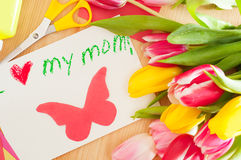 Bouquet of tulips and card with greetings for mother Royalty Free Stock Images