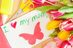Bouquet of tulips and card with greetings for mother Royalty Free Stock Photos