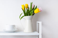 Bouquet of tulips and a cup Stock Photo