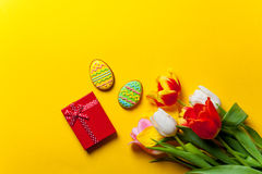 Bouquet of tulips and Easter cookies Royalty Free Stock Photography