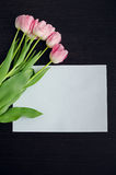 Bouquet of tulips and an empty paper Royalty Free Stock Image