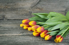 Bouquet of tulips flowers on a wooden background right side. Spring flowers. Women`s Day background with flowers. Royalty Free Stock Photography