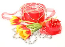 Bouquet of tulips and gift Stock Images