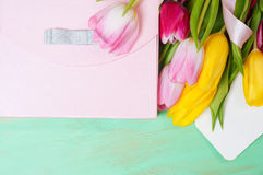 Bouquet of tulips,  gift box and blank greeting card Stock Photography