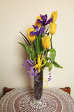 Bouquet of tulips and irises. Bouquet of yellow tulips and purple irises in the vase Royalty Free Stock Image