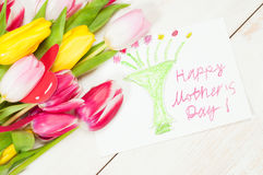 Bouquet of tulips  and kid`s picture for mother Royalty Free Stock Photography