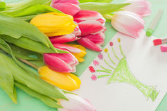 Bouquet of tulips  and kid`s picture for mother Stock Photos