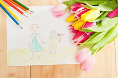 Bouquet of tulips and kids picture with mother and daughter on t Royalty Free Stock Photo
