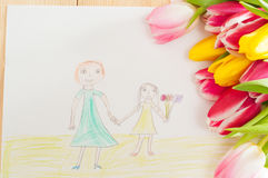 Bouquet of tulips and kids picture with mother and daughter on t Stock Images