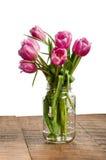 Bouquet of tulips in a mason jar Stock Photos