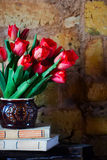 Bouquet of tulips and old books Stock Photography