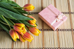 Bouquet of Tulips and Pink Gift Box Stock Photography