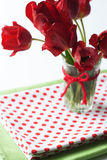 Bouquet of tulips and a polka dot tablecloth Stock Photo