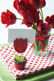 Bouquet of tulips and a polka dot tablecloth Royalty Free Stock Images
