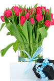 Bouquet of tulips and a present Royalty Free Stock Image