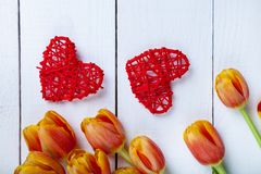 Bouquet of tulips and red hearts Royalty Free Stock Images