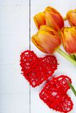 Bouquet of tulips and red hearts Stock Photo