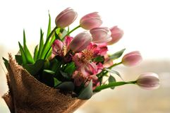Bouquet of tulips on the table with a note royalty free stock photos