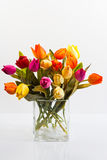 Bouquet of tulips in a vase. Bouquet of tulips different colors on a white background Stock Photos