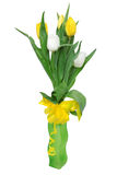 Bouquet of Tulips in a Vase. Bouquet of yellow and white tulips in a green matted vase with a yellow ribbon bow isolated on white Stock Image