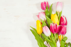 Bouquet of tulips  on the wooden background Royalty Free Stock Images