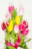 Bouquet of tulips  on the wooden background Royalty Free Stock Photography