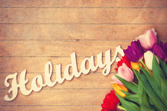 Bouquet of tulips and word Holidays Stock Photography