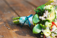 Bouquet with turquoise ribbon Royalty Free Stock Photo