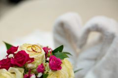 Bouquet and Two Wedding Rings. White swans, hearts made out of towels. Goods for wedding: Bouquet and two Rings. Photo is perfect for magazines, shops dealing Stock Photos