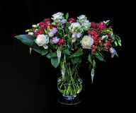 A bouquet of varied flowers. A bouquet of mixed flowers against a black background Royalty Free Stock Image