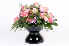 Bouquet in vase. Beautiful bouquet with pink roses in black vase stock photo