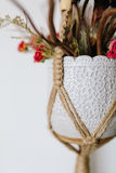 Bouquet in a vase jewelry Knitted macrame terrarium holder . On stock images