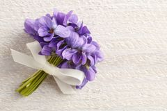 Bouquet of violet flowers viola odorata and vintage letters Stock Photography