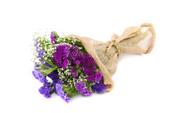 Bouquet of violet flowers on white background. Bouquet of violet flowers isolated on white background Stock Photography