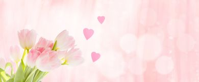Bouquet of tulips with hearts as a greeting stock images