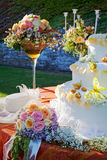 Bouquet and wedding cake. Bouquet and wedding cake on a table Stock Images
