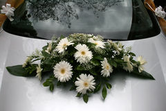 Bouquet on a wedding car. A closeup of white bouquet on a wedding car Royalty Free Stock Photography