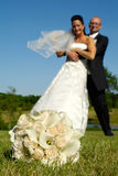 Bouquet and wedding couple Stock Images