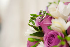 Bouquet and wedding dress Stock Photos