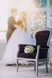 Bouquet wedding flowers daisies in a luxurious chair in the back Royalty Free Stock Photos