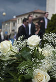 Bouquet and wedding guests Stock Photography