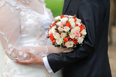 Bouquet and Wedding Hug Stock Photo