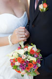 Bouquet and wedding ring Stock Photography