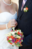 Bouquet and wedding ring Stock Images