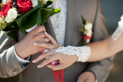 Bouquet and wedding rings Stock Image