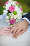 Bouquet and wedding rings Stock Images
