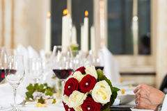 Bouquet at a wedding table Royalty Free Stock Photo