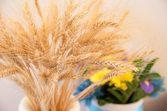 A bouquet of wheat and a bouquet of wild flowers stock images